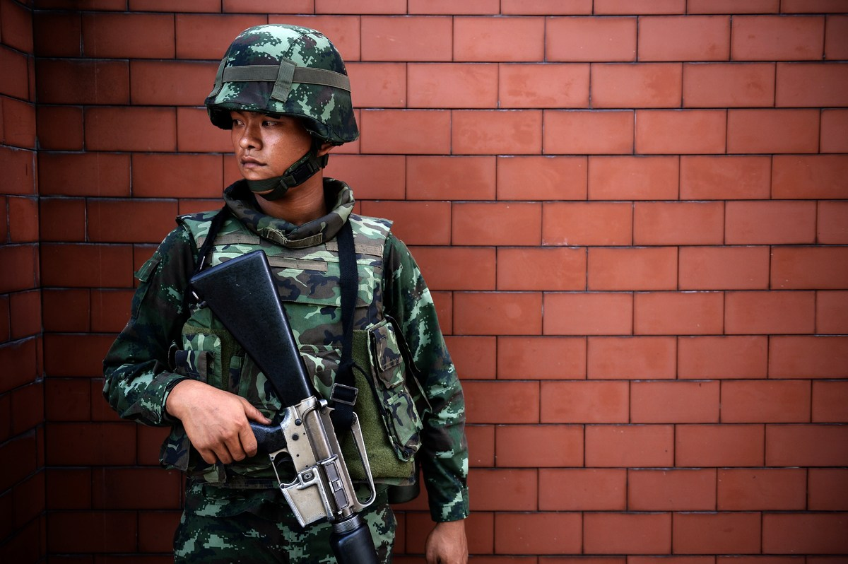 A Thai soldier stands outside the Government Public Relations Department after martial law was imposed in Bangkok on May 20,