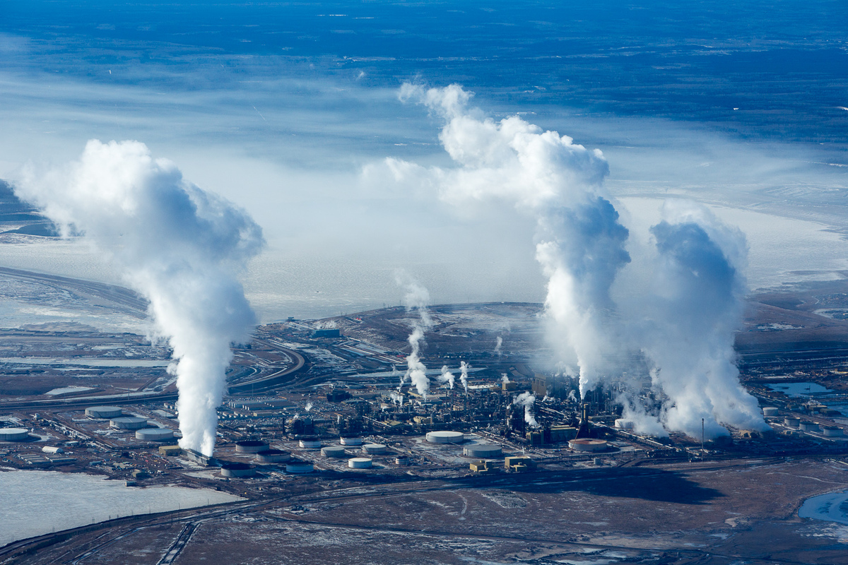 Steam and smoke rises at Syncrude's Mildred Lake upgrade refinery.