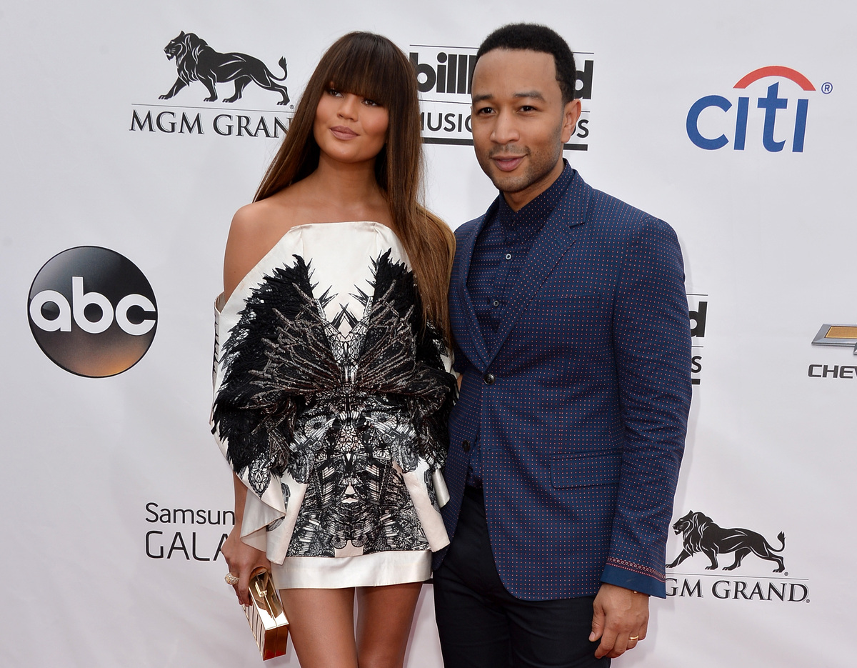 Chrissy Teigen and husband John Legend will reportedly be counted among Kimye's guests.