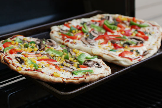 """<strong>Get the <a href=""""http://www.macheesmo.com/2011/05/grilled-veggie-pizza/"""" target=""""_blank"""">Grilled Veggie Pizzas recipe"""