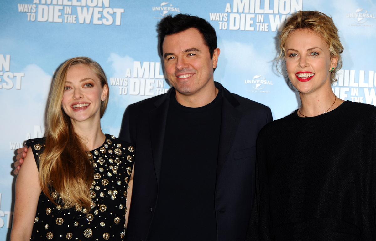 LONDON, ENGLAND - MAY 27:  Amanda Seyfried, Charlize Theron and Seth Macfarlane attend a photocall to promote 'A Million Ways