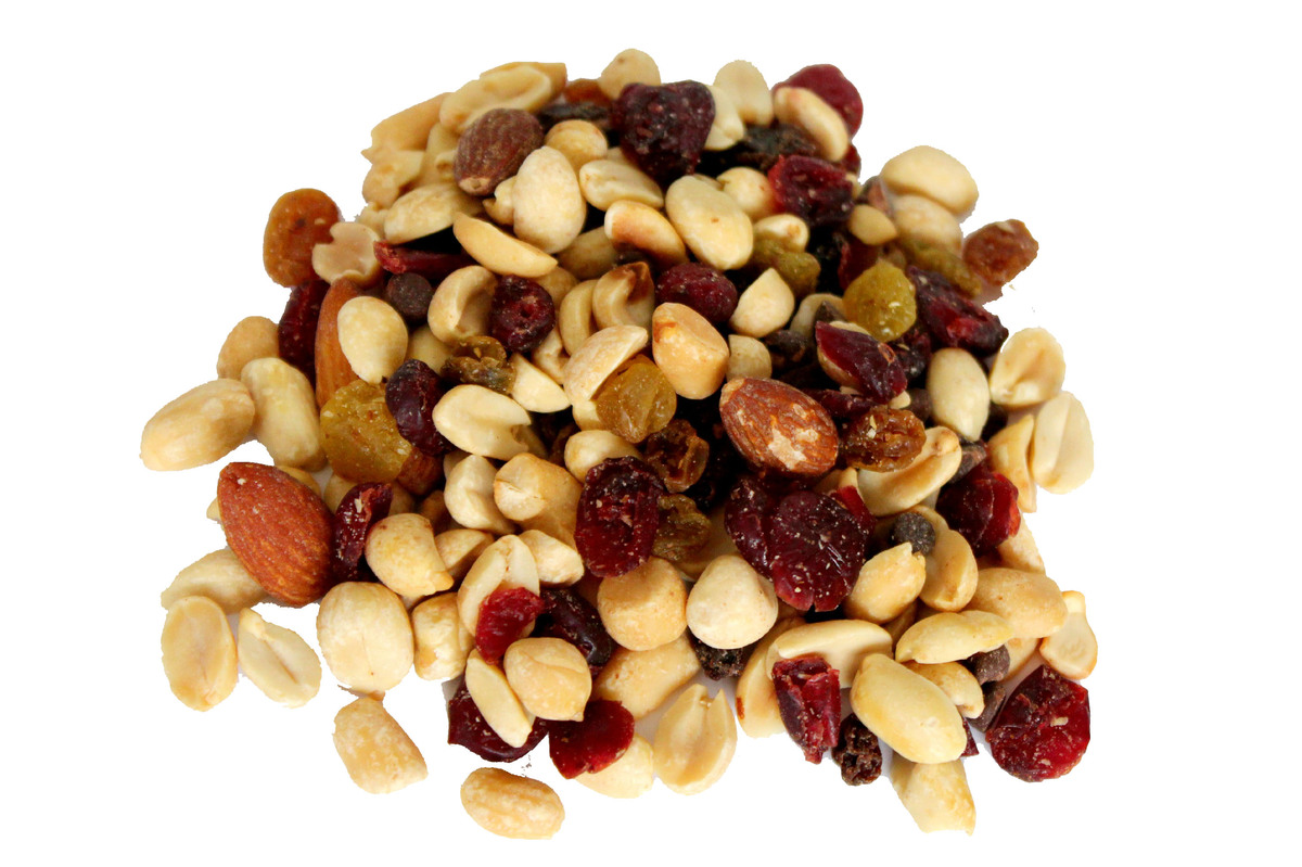 <strong>Reach for raw almonds and dried apricots.</strong> Store-bought trail mix can have extra sugar from chocolate candies