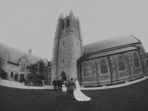 """Nina and Giancarlo share a moment after their wedding at Grace Episcopal Church."""