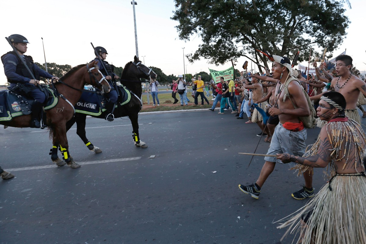 Indigenous protesters clash with military police during a protest against the World Cup outside the National Stadium in Brasi