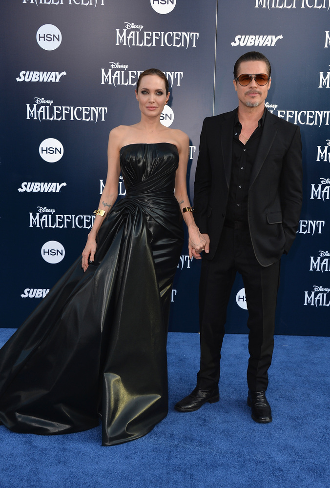 HOLLYWOOD, CA - MAY 28:  Actress Angelina Jolieand Brad Pitt arrive at the World Premiere Of Disney's 'Maleficent' at the El