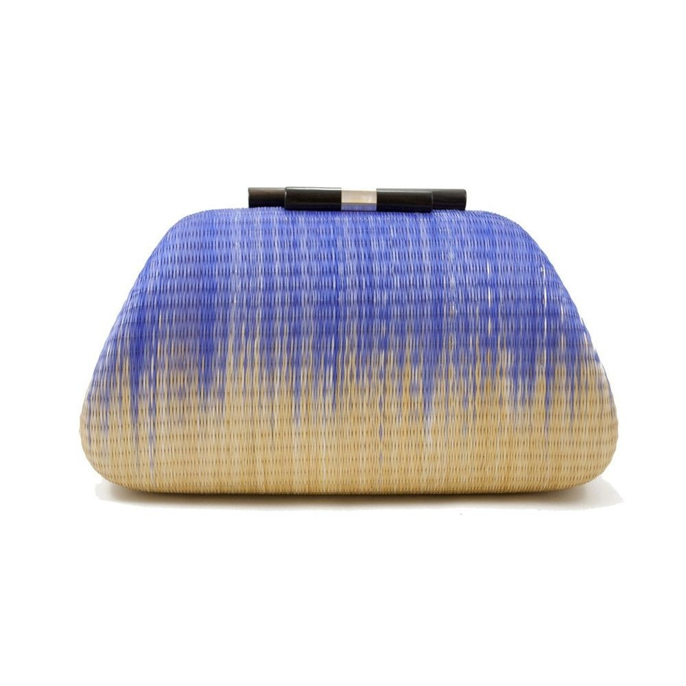 "The gorgeous clutches by <a href=""http://shop.kayudesign.com/products/madiera-straw"" target=""_blank"">Kayu</a> are colorful, c"