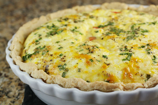 """<strong>Get the <a href=""""http://www.macheesmo.com/2011/04/smoked-salmon-quiche/"""" target=""""_blank"""">Smoked Salmon Quiche</a> rec"""