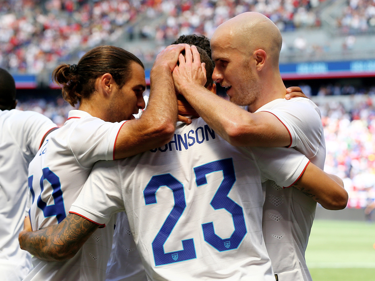 HARRISON, NJ - JUNE 01:  Graham Zusi #19 and Michael Bradley #4 of the United States congratulate teammate Fabian Johnson #23