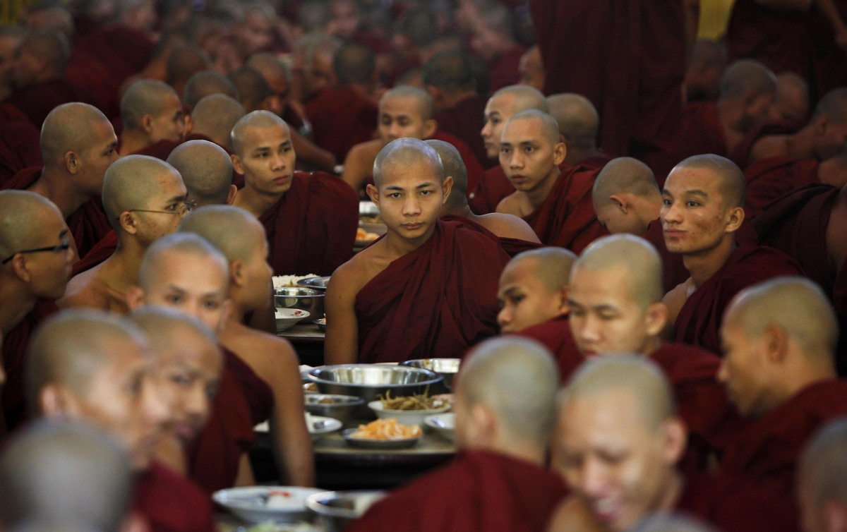 Buddhist monks gather in a monastery's dining hall to consume alms offered by devotees in Bago, about 60 kilometers (40 miles