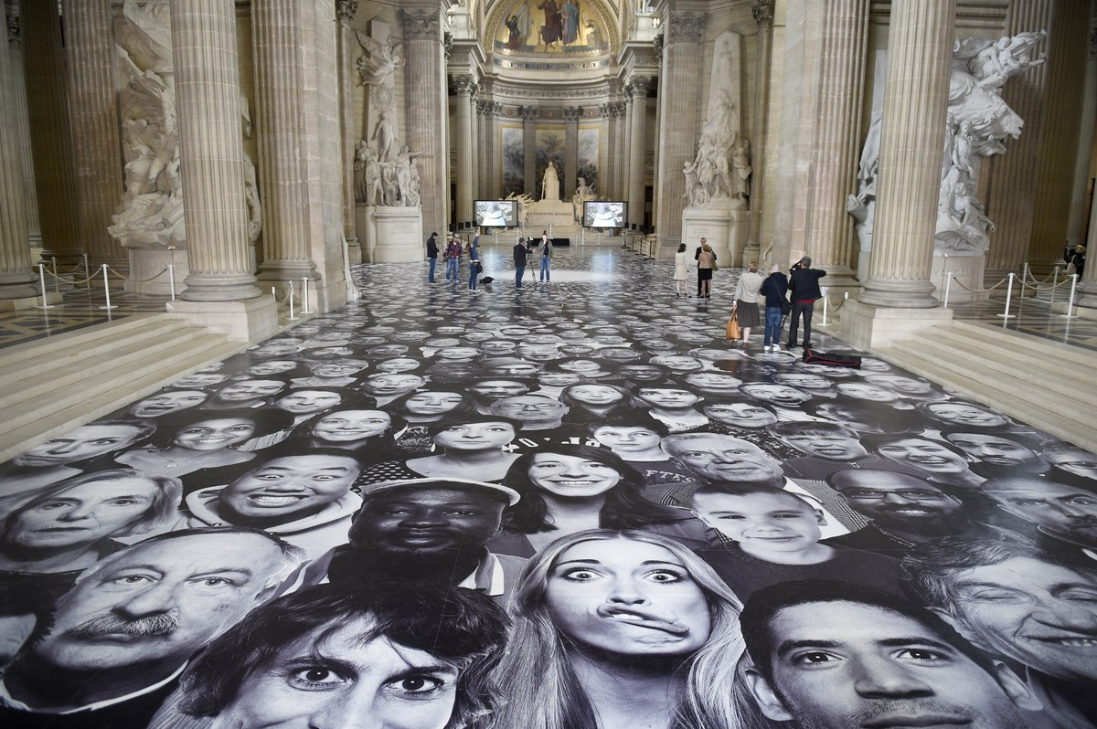"People visit the exhibition ""Au Pantheon!"" by French photographer JR at the Pantheon in Paris, a secular temple which contain"
