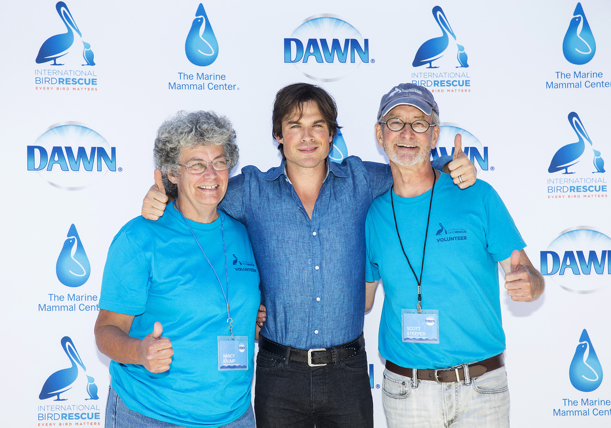 Actor Ian Somerhalder with volunteers from International Bird Rescue, Scott Steeper and Nancy Kaump, celebrating the launch o