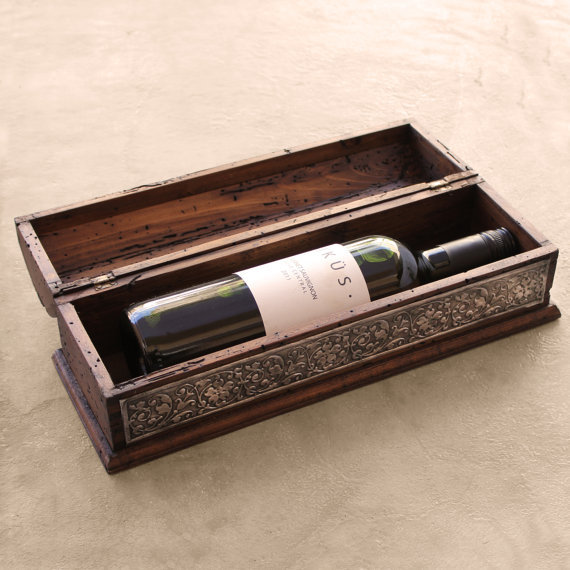 If the bride and groom have a fancy collection of wine bottles they'll probably never open, this rustic box is perfect.   <a