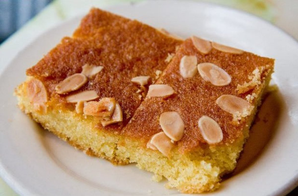 This delicious cake, also called hareesa (in Syria and Palestine) or ravani (in Greece), is made from semolina soaked in syru