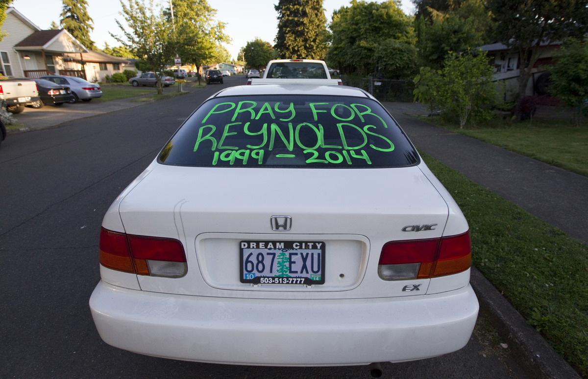 GRESHAM, OR - JUNE 10:  A student's car bears the message to 'Pray fro Reynolds 1999-2014'  as its parked near a church  hold
