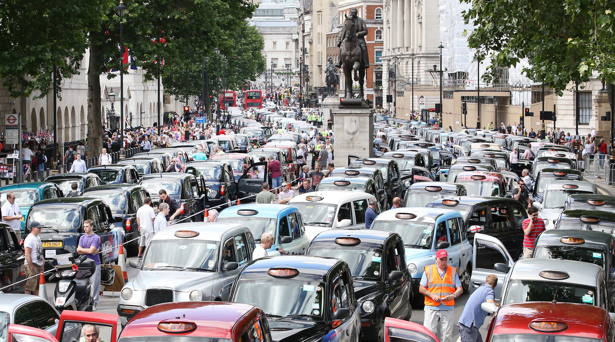 LONDON, ENGLAND - JUNE 11:  Taxis blockade Whitehall on June 11, 2014 in London, England. London's licensed black taxi driver
