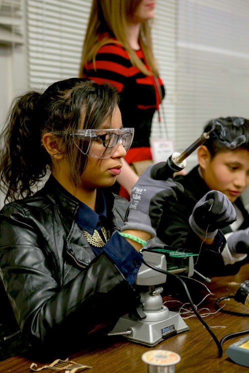 A student in Durham, N.C., demonstrates how soldering works.