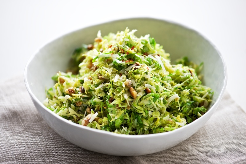 """<a href=""""http://pixelsandcrumbs.com/blog/2014/4/1/shaved-brussels-sprouts-with-pecorino-walnuts"""" target=""""_blank"""">Get the reci"""