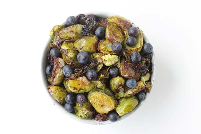 """<a href=""""http://www.thehealthymaven.com/2014/03/roasted-rosemary-brussels-sprouts-w-blueberries.html"""" target=""""_blank"""">Get the"""