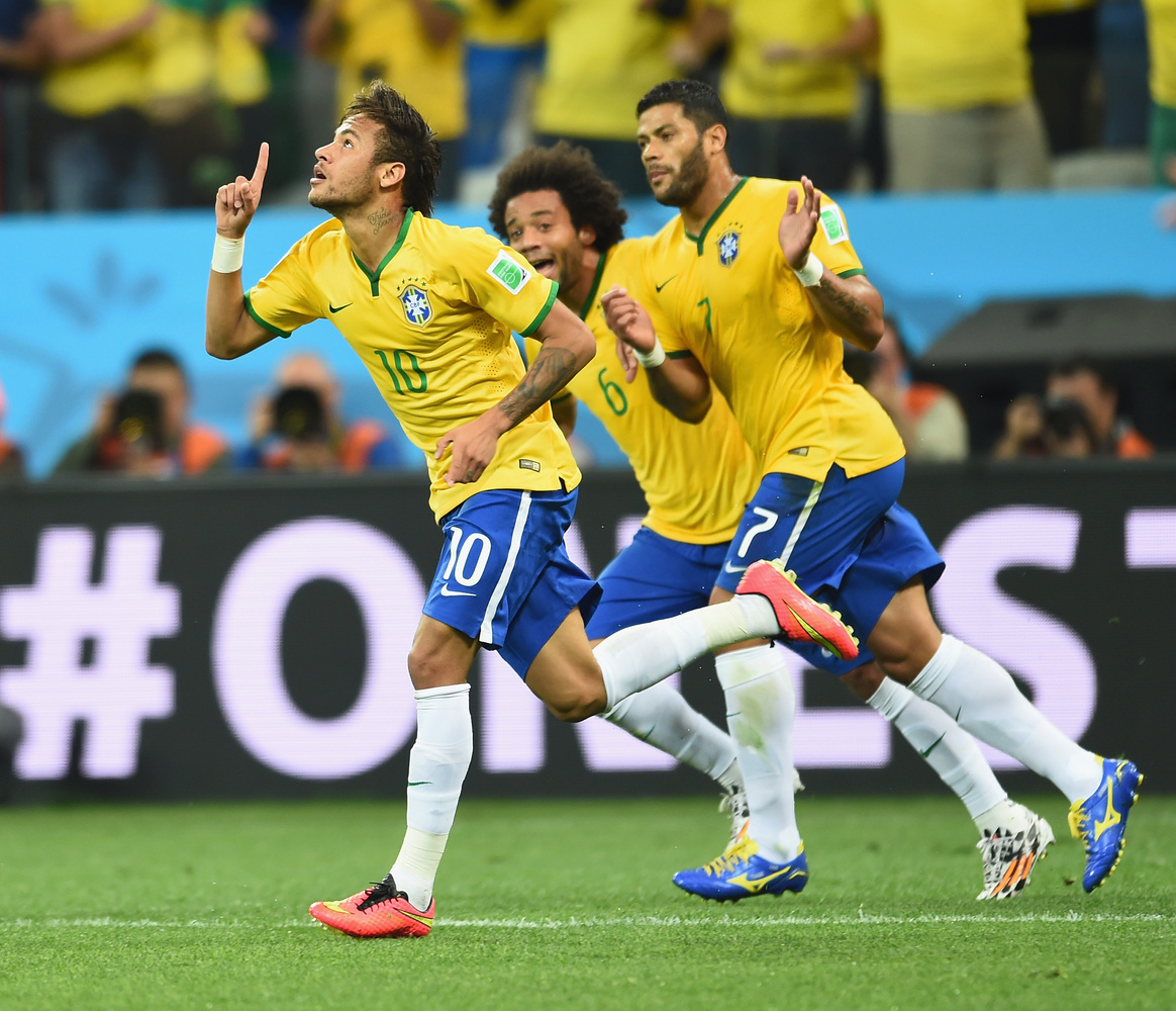 SAO PAULO, BRAZIL - JUNE 12: Neymar of Brazil celebrates scoring a first half goal with Marcelo and Hulk during the 2014 FIFA