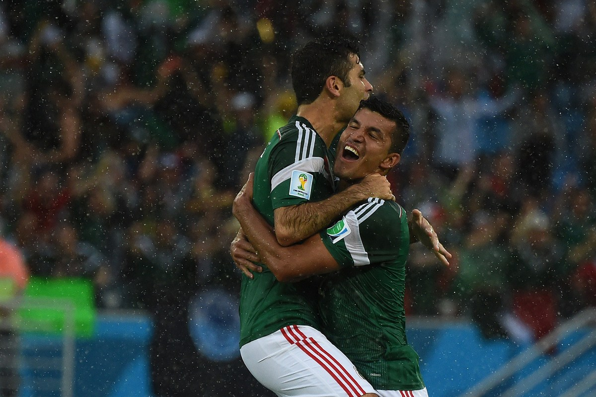 Mexico's defender and captain Rafael Marquez and Mexico's defender Francisco Rodriguez (R) celebrate after their team scored