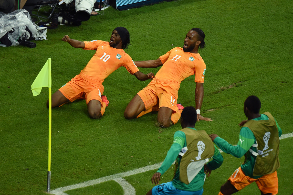 RECIFE, BRAZIL - JUNE 14:  Gervinho of the Ivory Coast (L) celebrates scoring his team's second goal with teammate Didier Dro