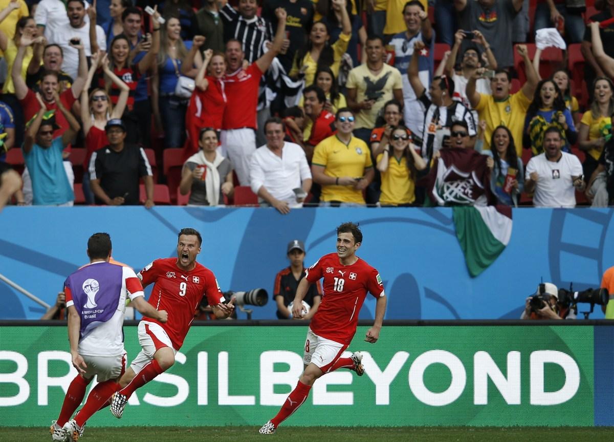 Switzerland's forward Haris Seferovic (C) celebrates scoring with his teammates during a Group E football match between Switz