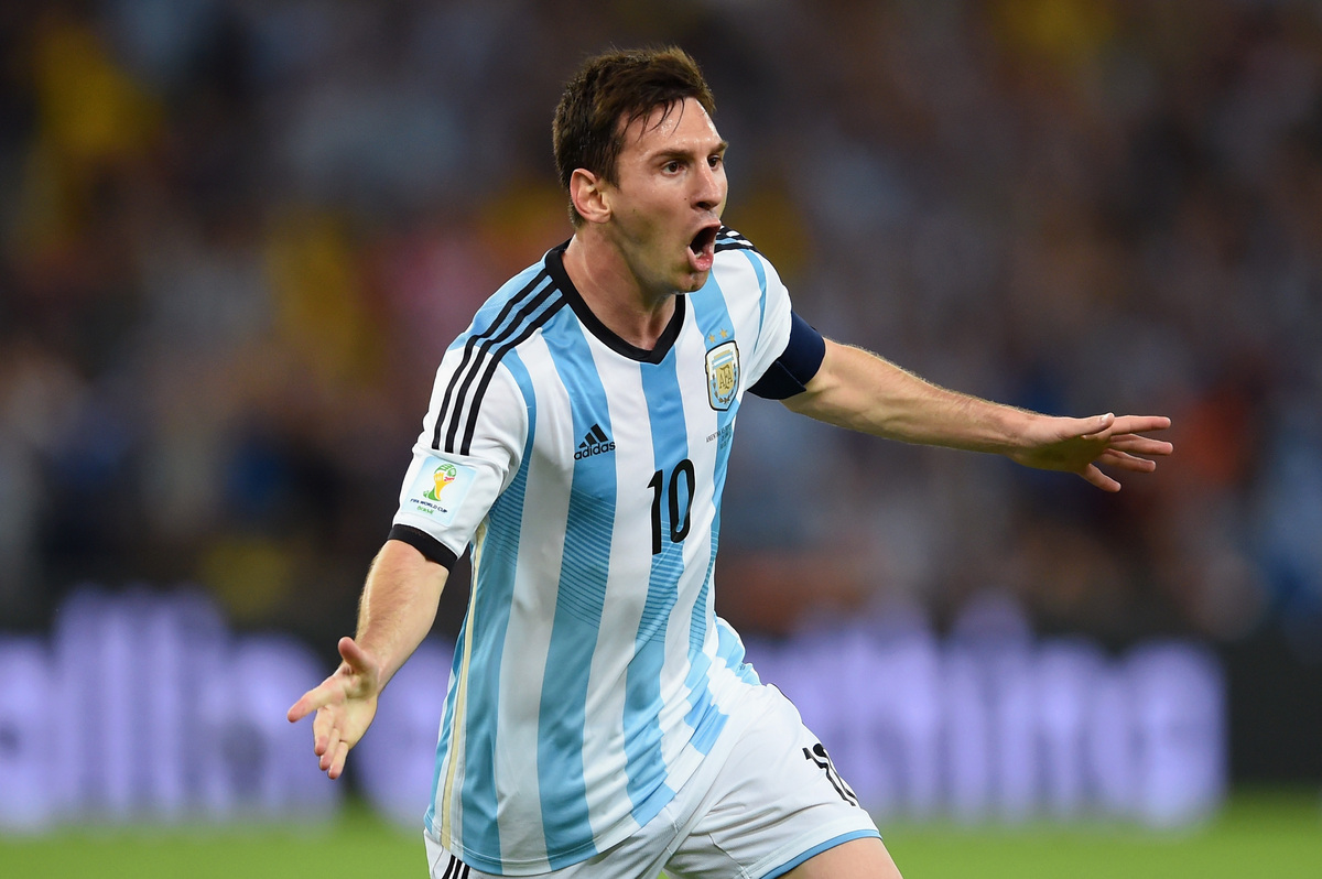 RIO DE JANEIRO, BRAZIL - JUNE 15:  Lionel Messi of Argentina reacts after scoring his team's second goal during the 2014 FIFA
