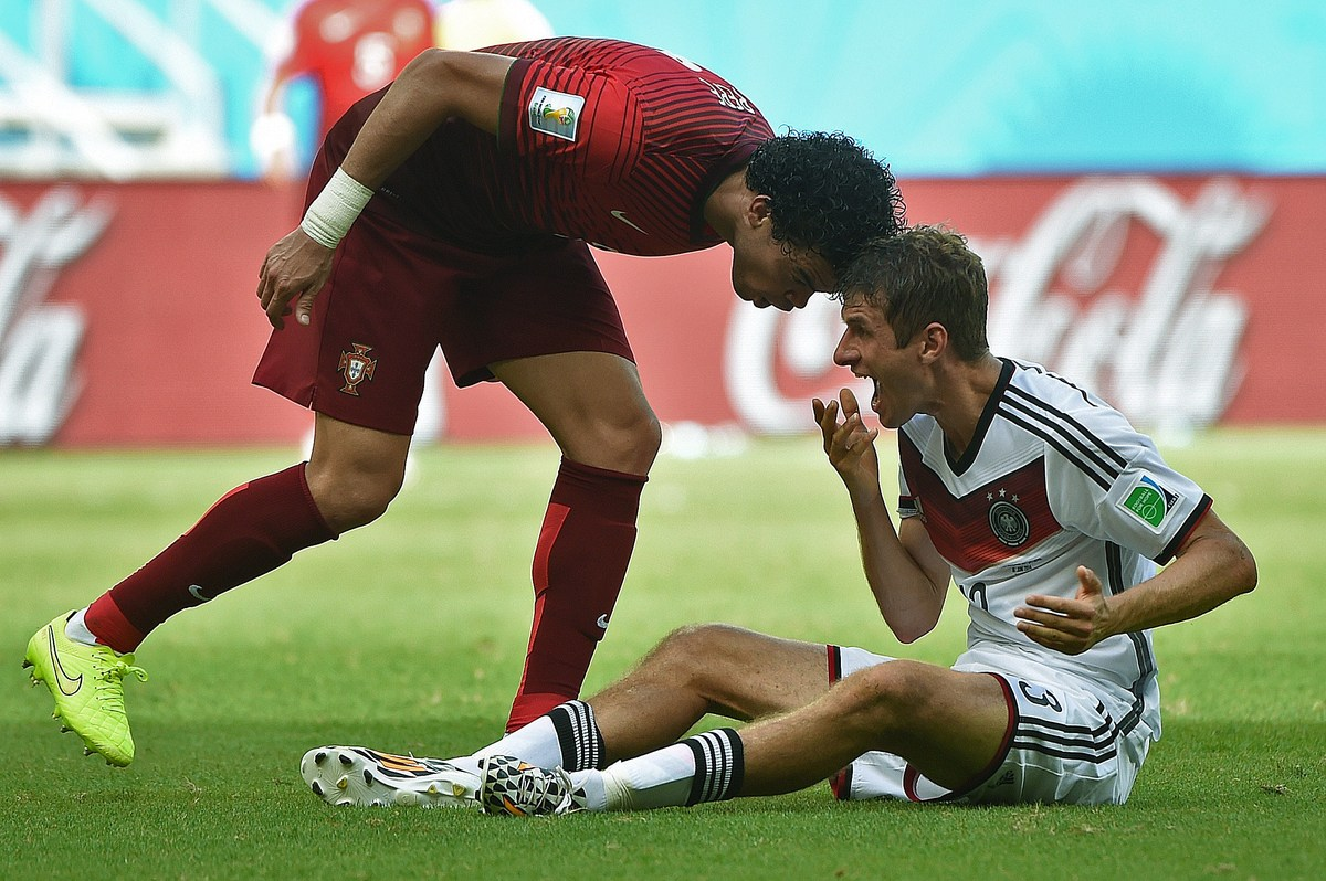 Portugal's defender Pepe (R) fouls Germany's forward Thomas Mueller before being sent off during the Group G football match b