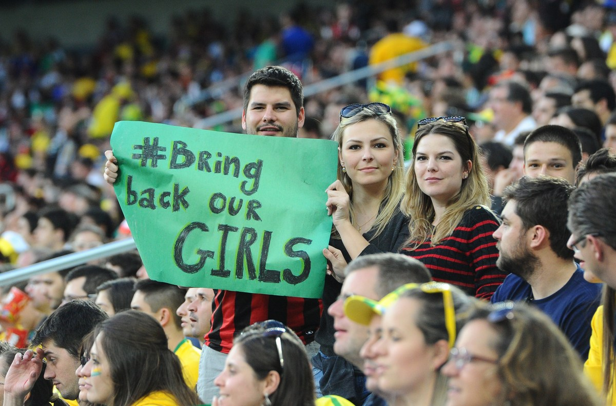 Fans hold a sign reading 'Bring back our girls' in support of more than 200 Nigerian schoolgirls kidnapped by Boko Haram as t