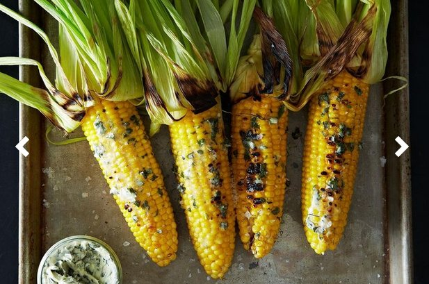 "<strong>Get the <a href=""http://food52.com/recipes/21960-grilled-corn-with-basil-butter"" target=""_blank"">Grilled Corn With Ba"