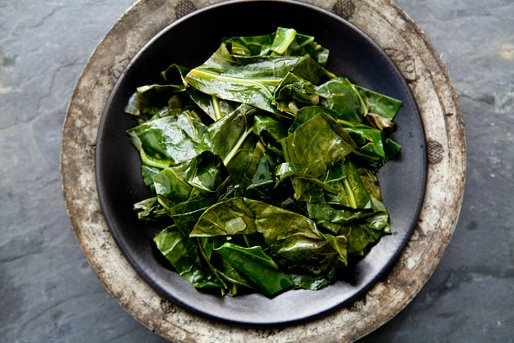 "<strong>Get the <a href=""http://www.simplyrecipes.com/recipes/collard_greens/"" target=""_blank"">Collard Greens</a> recipe from"