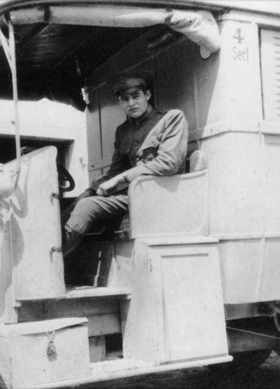 Ernest Hemingway seated in a Red Cross ambulance, Italy, 1918.