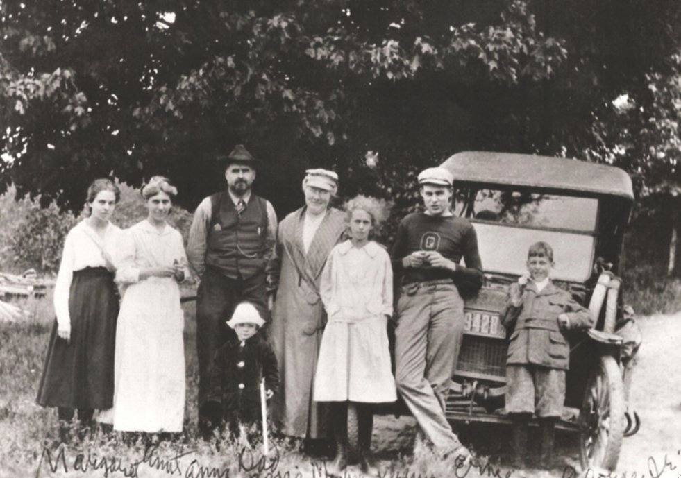 """The Hemingways arrive in Michigan by car in 1917. Ernest is wearing his high school """"letter sweater."""""""