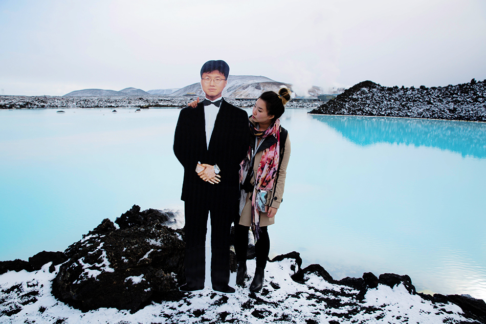 Jinna Yang and a cutout of her father at the Blue Lagoon in Iceland.