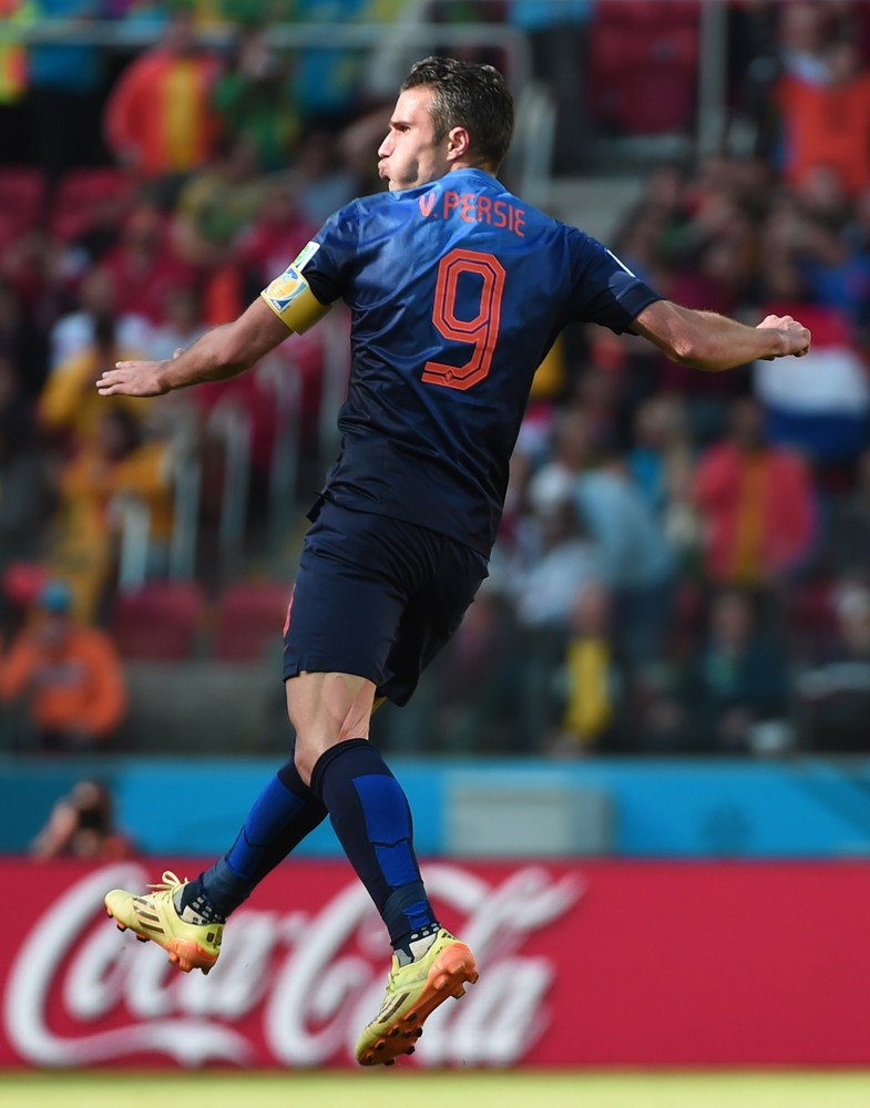 Netherlands' forward and captain Robin van Persie celebrates after scoring during a Group B football match between Australia