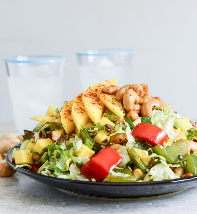 "<strong>Get the <a href=""http://www.howsweeteats.com/2013/08/cashew-chicken-chopped-salad-with-chili-dusted-mango/"" target=""_"