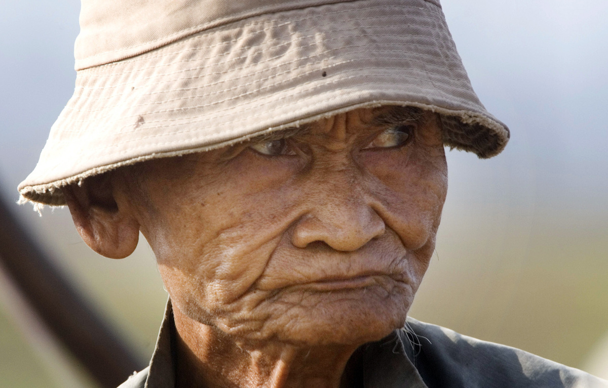 A Local Cambodian villager, Choeung Soeung, 73, looks on as his plows farm field before planting rice in Kob Srov village, about 18 kilometers (11 miles) northwest of Phnom Penh, Cambodia, Thursday, June 10, 2010. (Heng Sinith/AP)