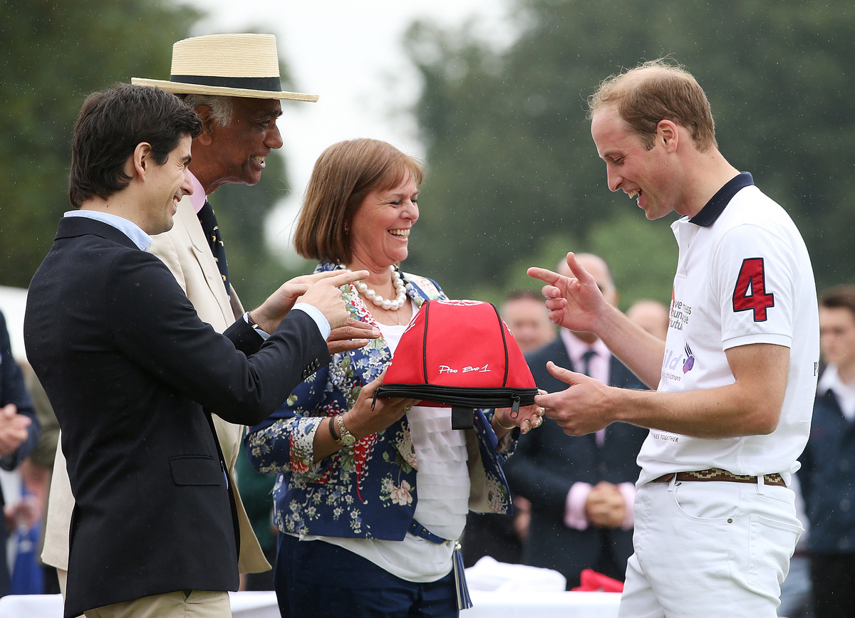 <i>Being presented with the most valuable player of the match at the Royal Charity Polo during the Maserati Jerudong Trophy a