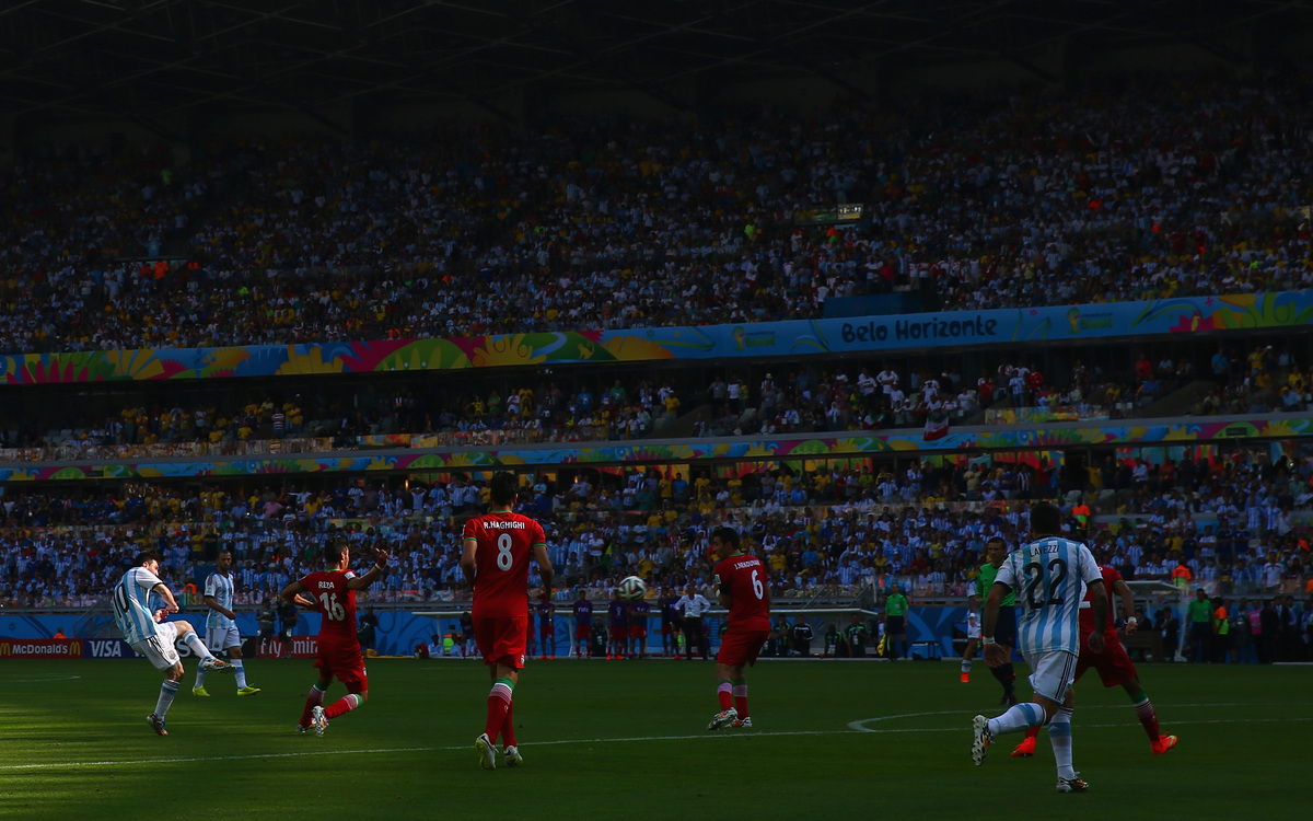 BELO HORIZONTE, BRAZIL - JUNE 21:  Lionel Messi of Argentina shoots and scores his team's first goal during the 2014 FIFA Wor