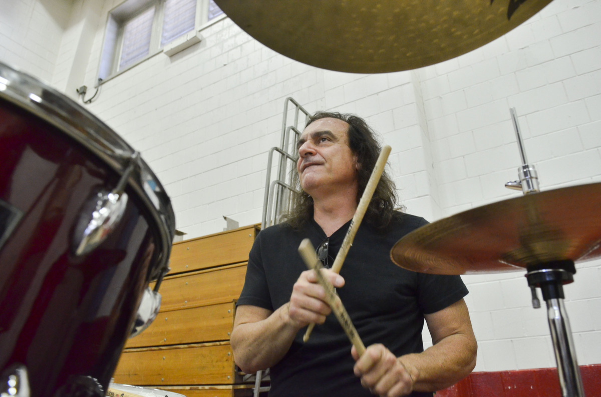 "Vinny Appice takes his turn on the drum kit. He and his brother play with their sticks backwards to produce a ""thicker sound"""
