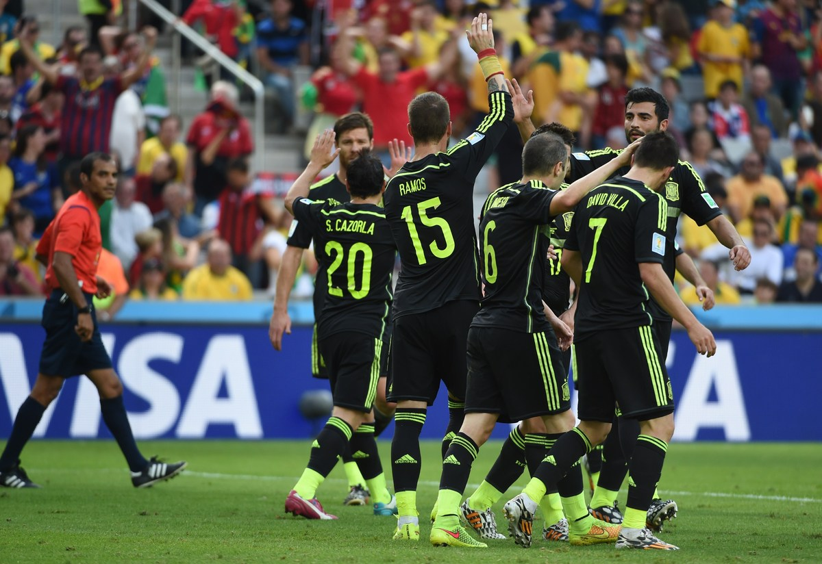 Spain's forward David Villa (R) celebrates with teammates after scoring during a Group B football match between Australia and