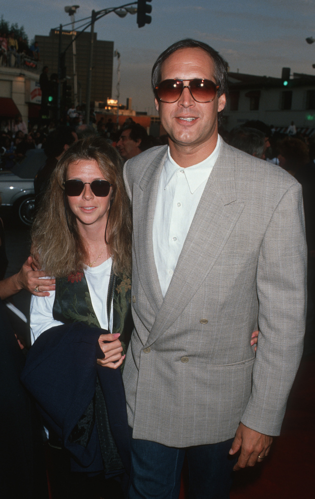 "Jayni Chase and Chevy Chase during ""Batman"" Los Angeles Premiere at Mann Village theater in Westwood, California, United Stat"