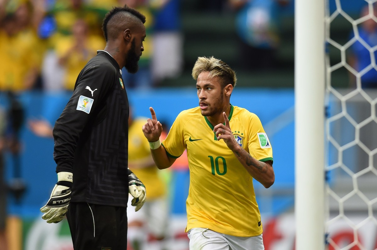 Brazil's forward Neymar celebrates after scoring during a Group A football match between Cameroon and Brazil at the Mane Garr