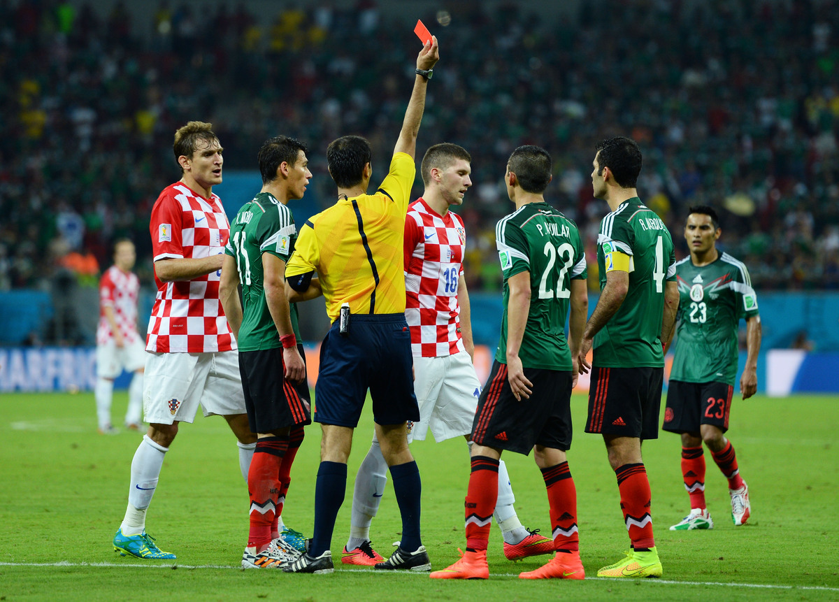 RECIFE, BRAZIL - JUNE 23:  Ante Rebic of Croatia receives a red card during the 2014 FIFA World Cup Brazil Group A match betw