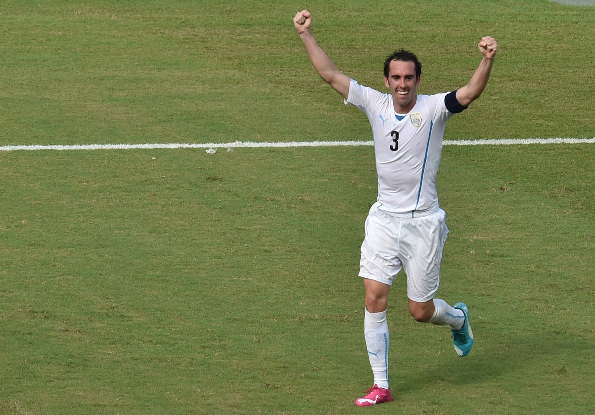 Uruguay's defender Diego Godin celebrates after scoring during a Group D football match between Italy and Uruguay at the Duna