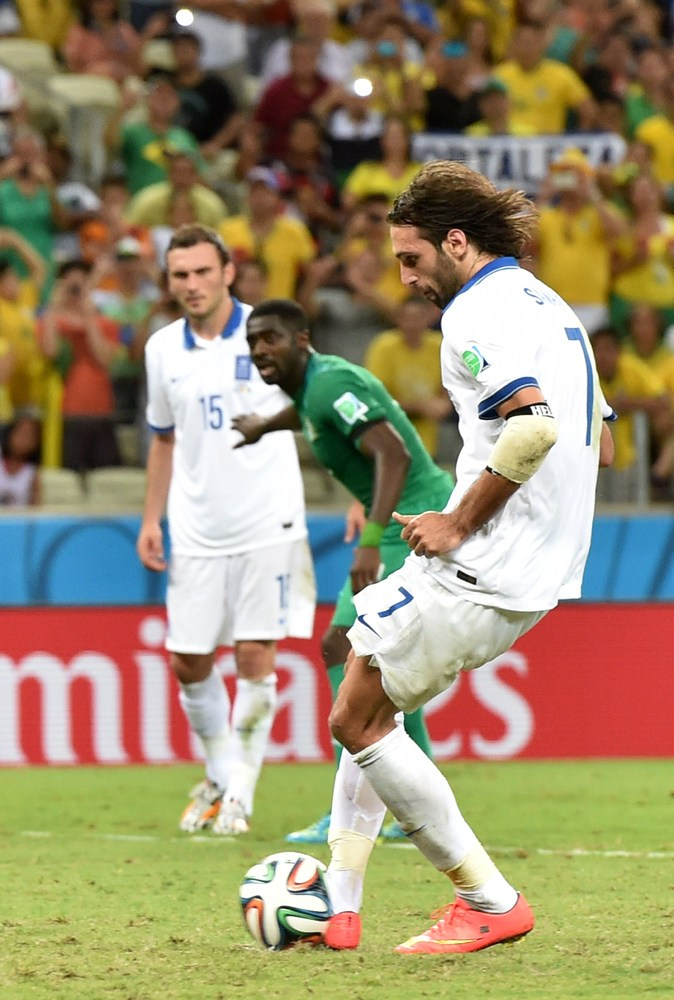 Greece's forward Georgios Samaras kicks and scores a penalty during a Group C football match between Greece and Ivory Coast a