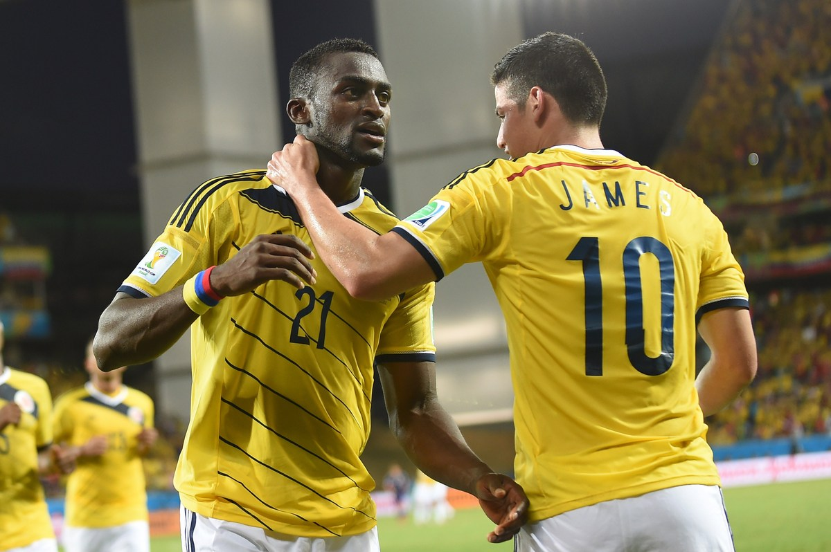Colombia's forward Jackson Martinez (L) celebrates with his teammate Colombia's midfielder James Rodriguez after scoring a go