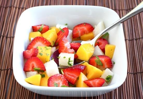 "<strong>Get the <a href=""http://www.twopeasandtheirpod.com/strawberry-mango-jicama-salad-recipe/"" target=""_blank"">Strawberry"