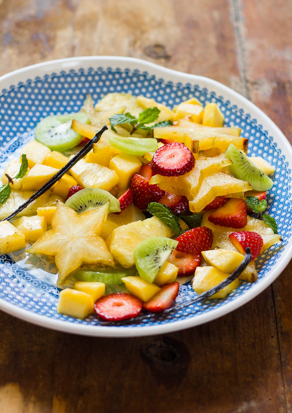 """<strong>Get the <a href=""""http://www.theclevercarrot.com/2014/05/tropical-spiced-fruit-salad-with-mangoes-mint/"""" target=""""_blan"""