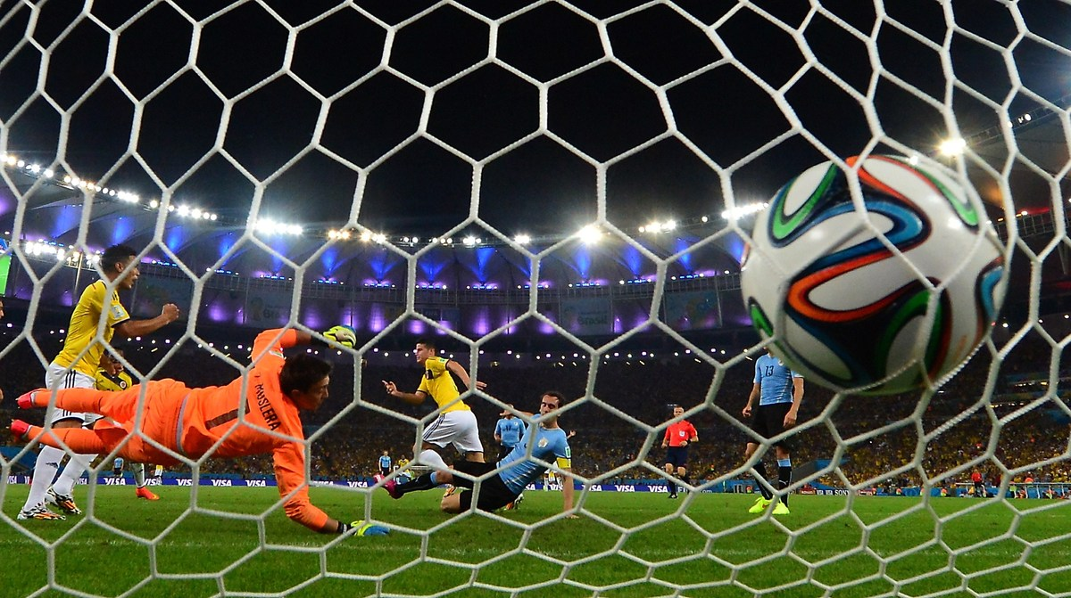 Uruguay's goalkeeper Fernando Muslera fails to save Colombia's midfielder James Rodriguez' second goal during the Round of 16